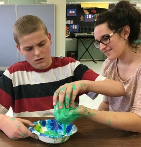 Student making slime.