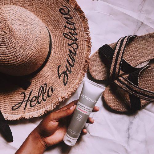 altruist-sunscreen-review-beach-essentials-hat-slippers-straw-bag-flatlay-affordable-sunscreens-nigeria-honeyricci-khairahscorner-pink-preset-darkroom