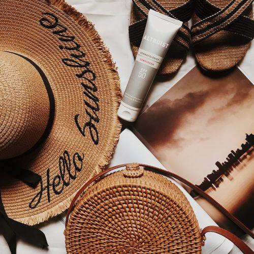 altruist-sunscreen-review-beach-essentials-hat-slippers-straw-bag-flatlay-affordable-sunscreens-nigeria-warm-brown-darkroom-preset-honeyricci-khairahscorner