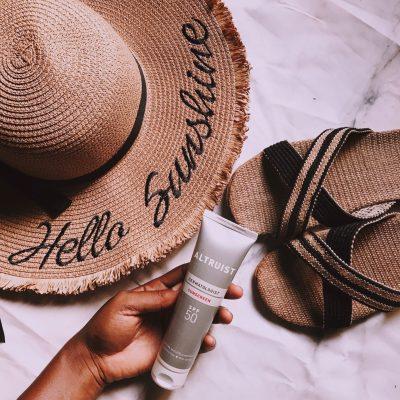 altruist-sunscreen-review-beach-essentials-hat-slippers-straw-bag-flatlay-pink-preset-darkroom-affordable-sunscreens-nigeria-honeyricci-khairahscorner