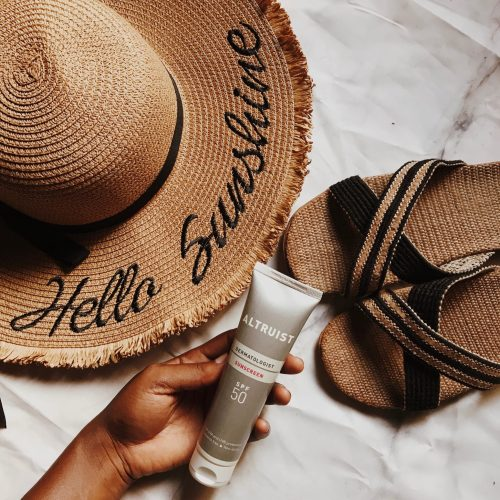 altruist-sunscreen-review-beach-essentials-hat-slippers-straw-bag-flatlay-warm-brown-preset-darkroom-affordable-sunscreens-nigeria-honeyricci-khairahscorner