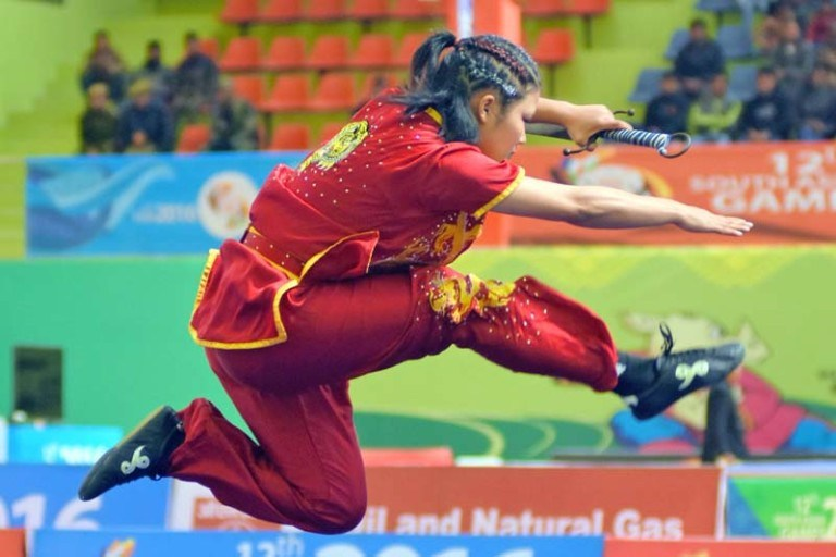 Nepali wushu player, Nima Gharti Magar, performing at the 12th South Asian Games, in Shilong of India, on Monday, February 8, 2016. Courtesy: Photojournalist Club