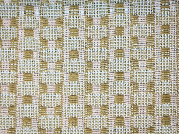 Close-up of fabric on a loom