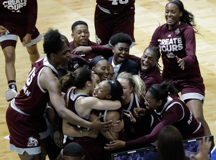 Mississippi State guard Morgan William, center, celebrates with teammates after she hit the winning shot at the buzzer in overtime to defeat Co_204366