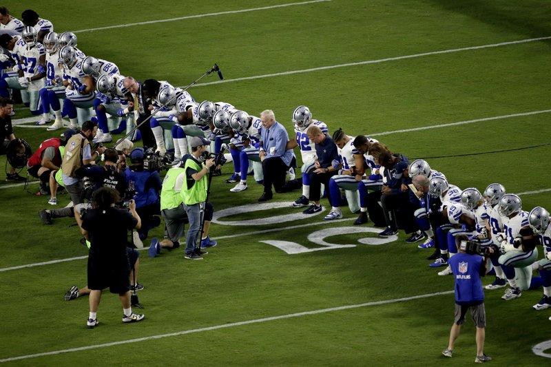 cowbows kneel before national anthem ap matt york_224477