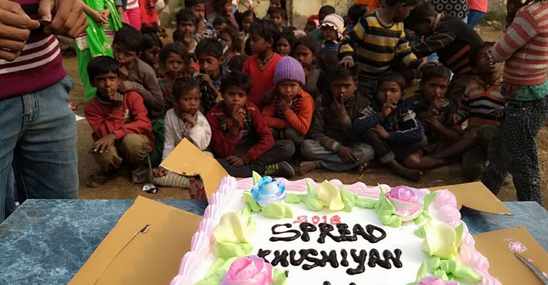 new year cake with shanti gyan trust children