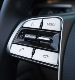 steering wheel mounted audio hands free phone and cruise control buttons [ 2880 x 1800 Pixel ]