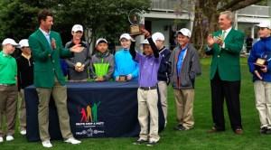 Adam Scott congratulates Boys 10-11 winner Leo Cheng