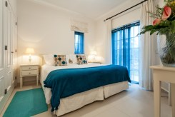 a restful bedroom in your villa