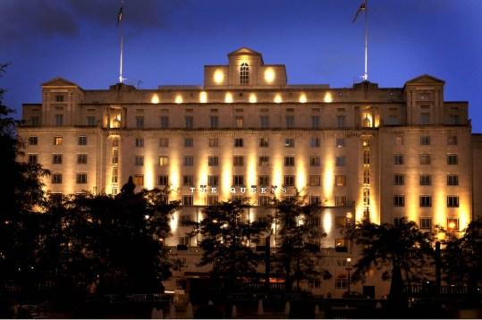 exterior shot of Queens Hotel lit up