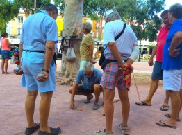 men playing boules in port grimaud