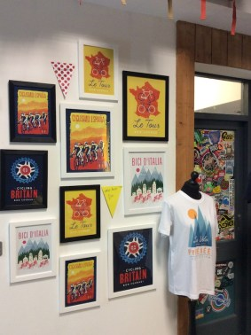 posters of cycling on wall