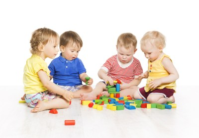 Children Group Playing Toy Blocks. Little Kids Early Development. Baby Activity One Year Old Games Isolated Over White Background