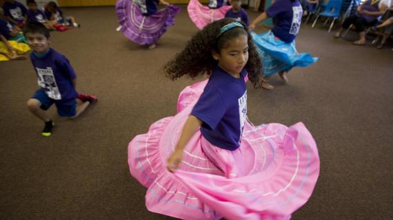 Children dancing at the AIU Latino Family Center