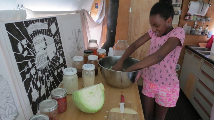 Kayla Younger learns how to make sauerkraut with special guest Fermentation on Wheels during a Youth Cook workshop