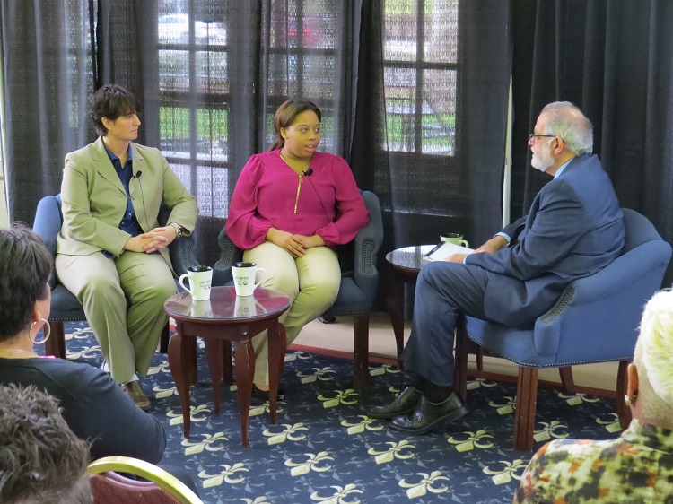 """Bob Nelkin speaks to Patti Camper, principal of Arsenal Middle School, and Jhenae, former Be There school attendance ambassador. at the """"United for Children"""" event."""
