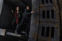"Hera Hilmar (left) as Hester Shaw and Robert Sheehan as Tom Natsworthy in ""Mortal Engines."" The film is directed by Christian Rivers, and written by Fran Walsh, Philippa Boyens and Peter Jackson based on the novel by Philip Reeve."