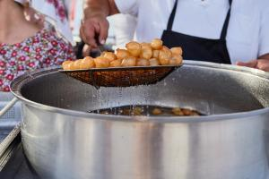 Loukoumades Greek pastry made of deep fried dough soaked in sugar syrup or honey and cinnamon