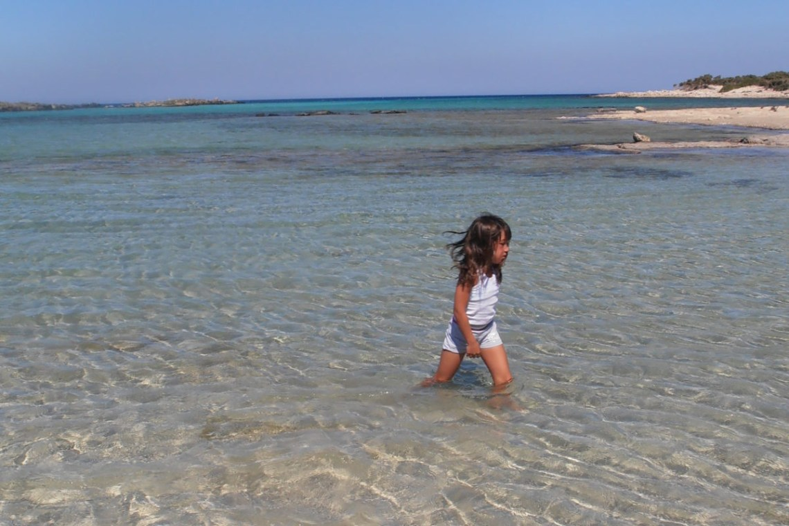 Kid having fun at the beach of Elafonisi