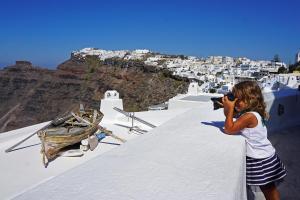 girl shooting photos in Santorini