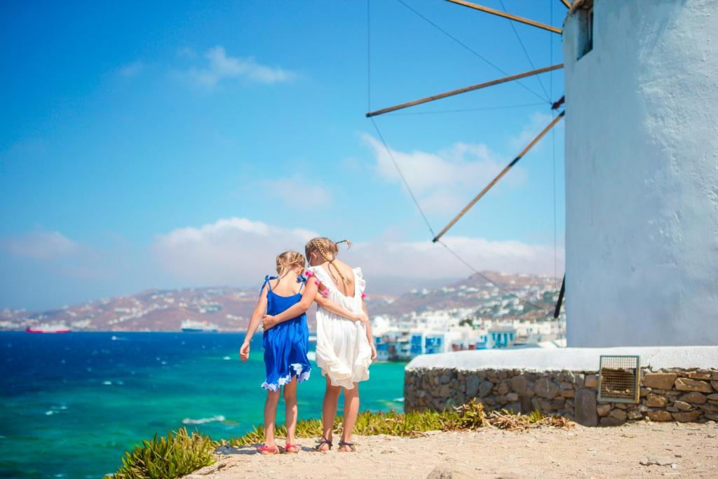 Girls next to windmills Mykonos