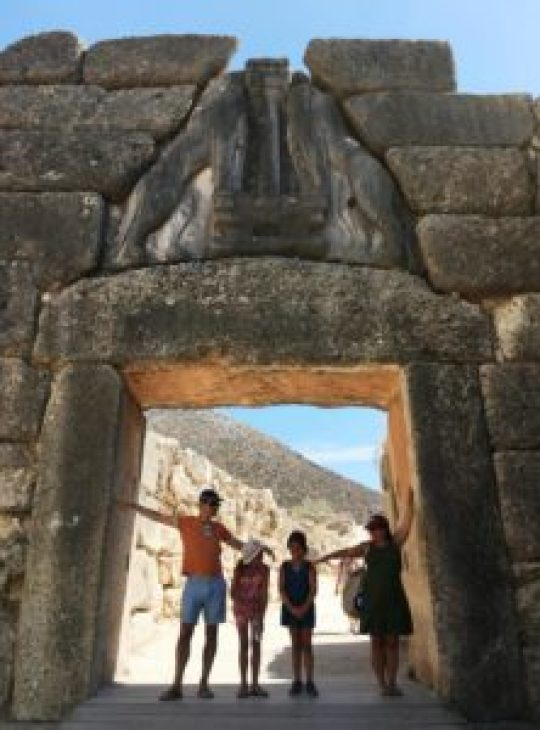 family at the entrance of Mycenae archeological site