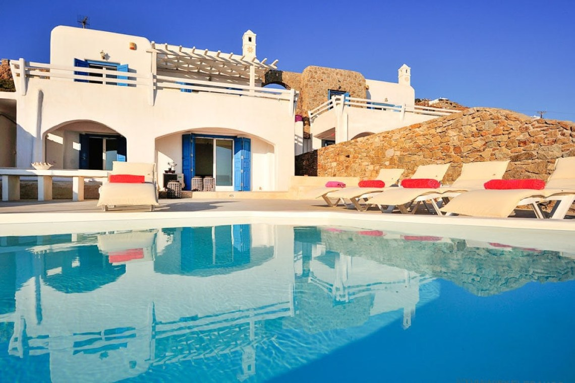 kids love greece accommodation modern family summer house in Mykonos island Delos view one Agios Stefanos traditional village Cyclades