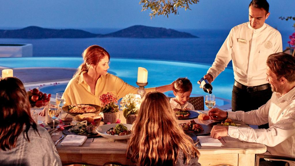 family dining at Elounda gulf villas pool
