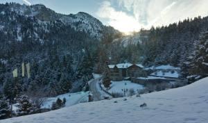 'Families Enjoying Winter Fun In The Snow In Greece