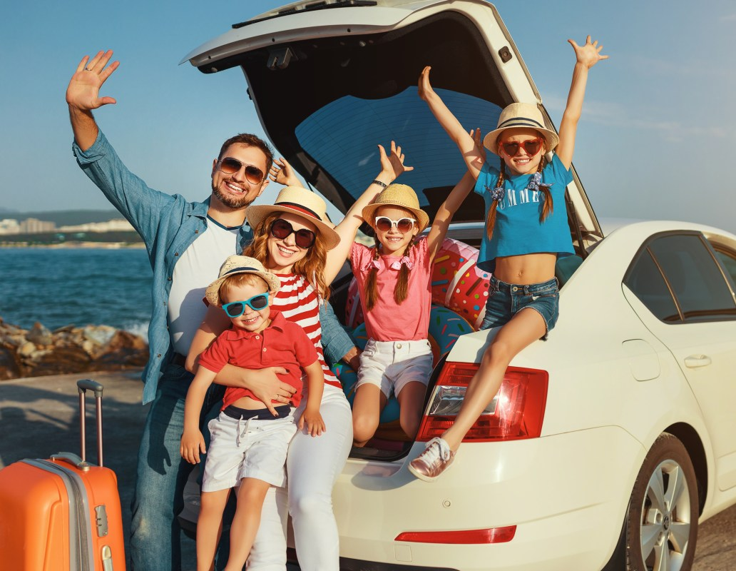 happy large family in summer auto journey travel by car on beach Self Drive Greece DP
