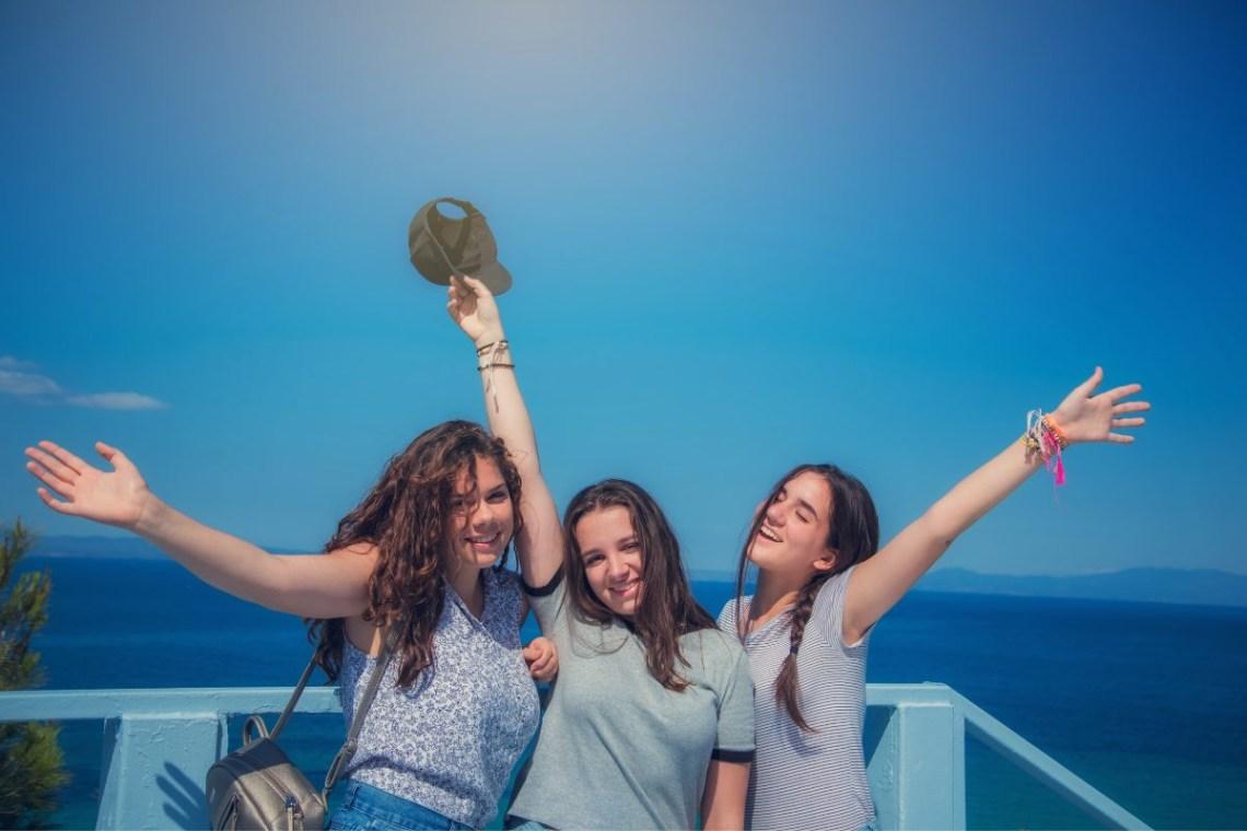 Teenagers happy on a boat island hopping Greek islands CV (1)