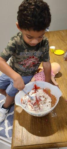 Boy mixing ingredients