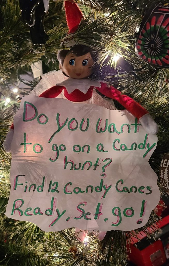 Elf on the Shelf in a Christmas tree