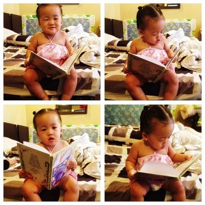 Daphnee enjoying her Mother Goose personalized book!