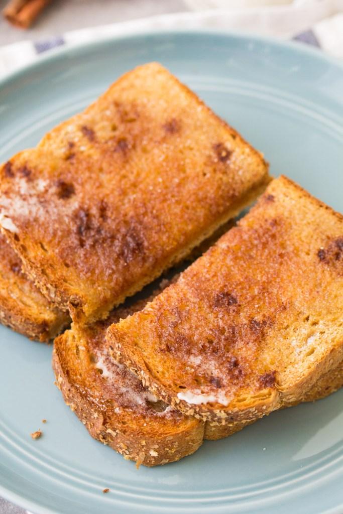 Slices of cinnamon sugar toast on a plate.