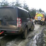 3 Land Rover's daisy chained together to winch a Land Rover Defender out of a ditch