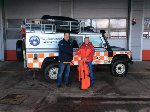 Russell Emmerson gratefully receives the new stretcher from Andrew Watson, Project Manager Balfour Beatty.