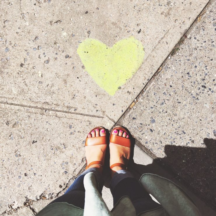 sandals next to heart on the sidewalk in new york city