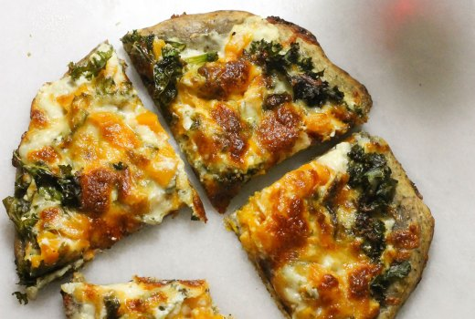 Butternut squash kale pizza with a glass of wine