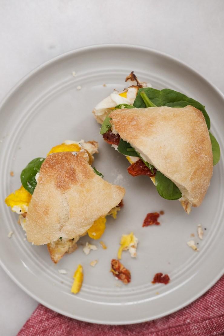 bite in a ciabatta breakfast sandwich
