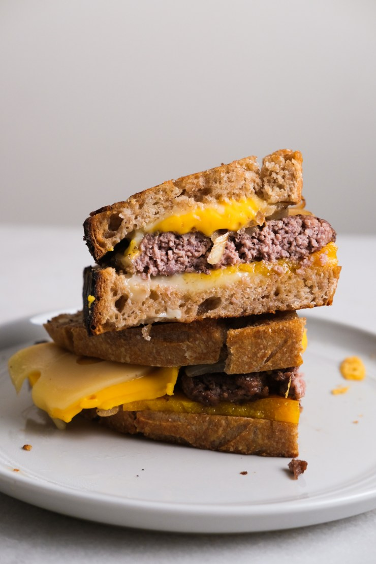 side view of patty melt on a plate