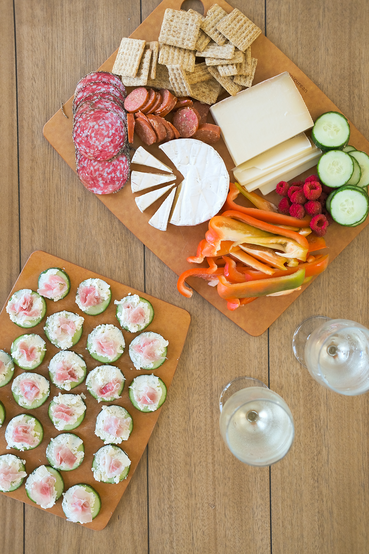 prosciutto cucumber bites with a cheese board