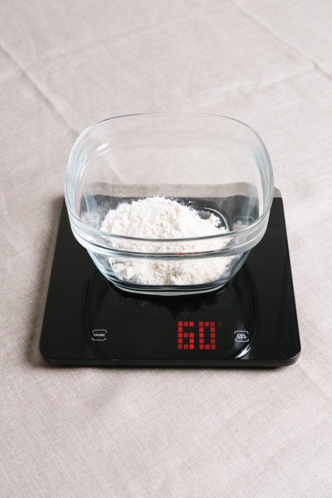 measuring out flour for sourdough starter