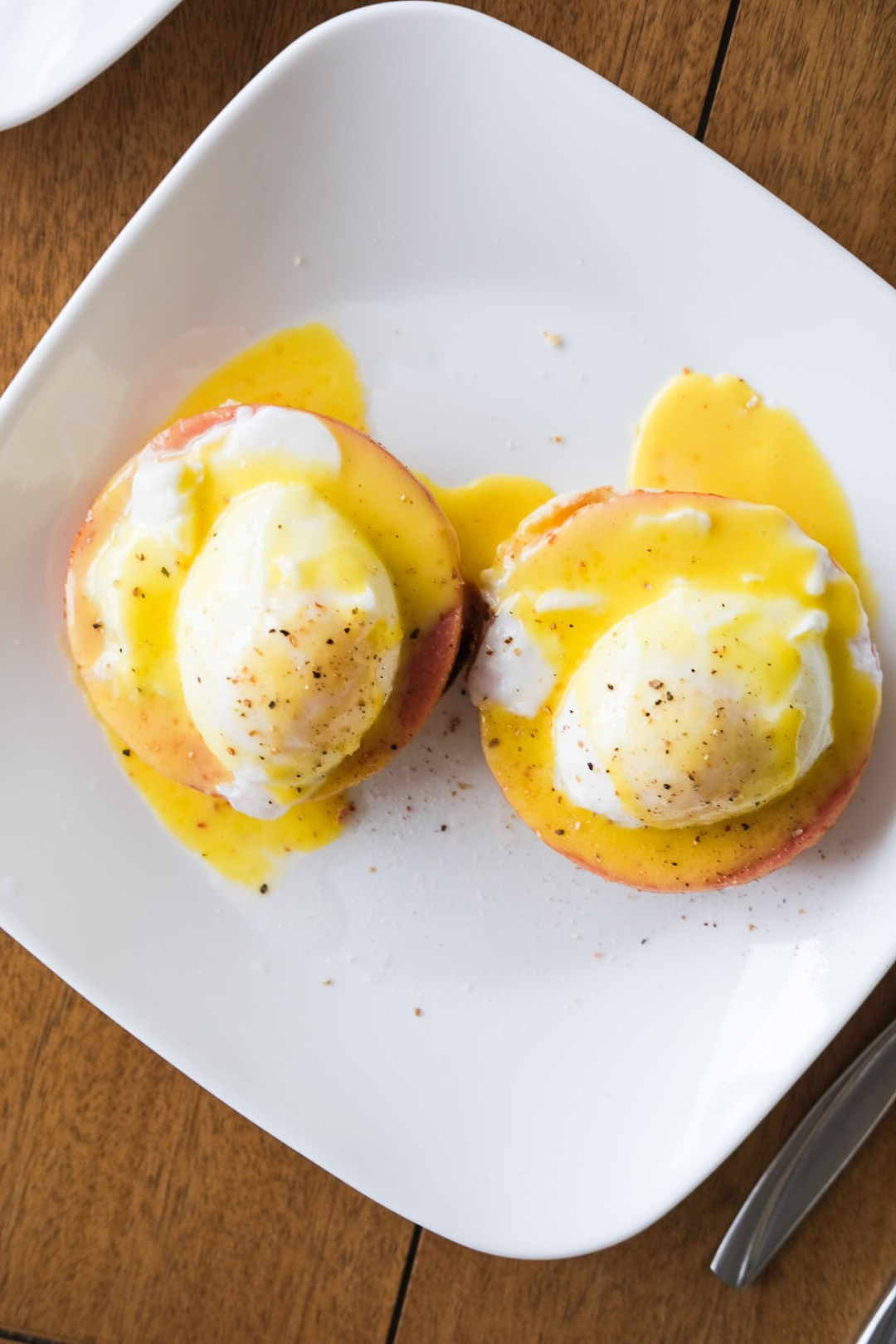 plate of eggs benedict with hollandaise