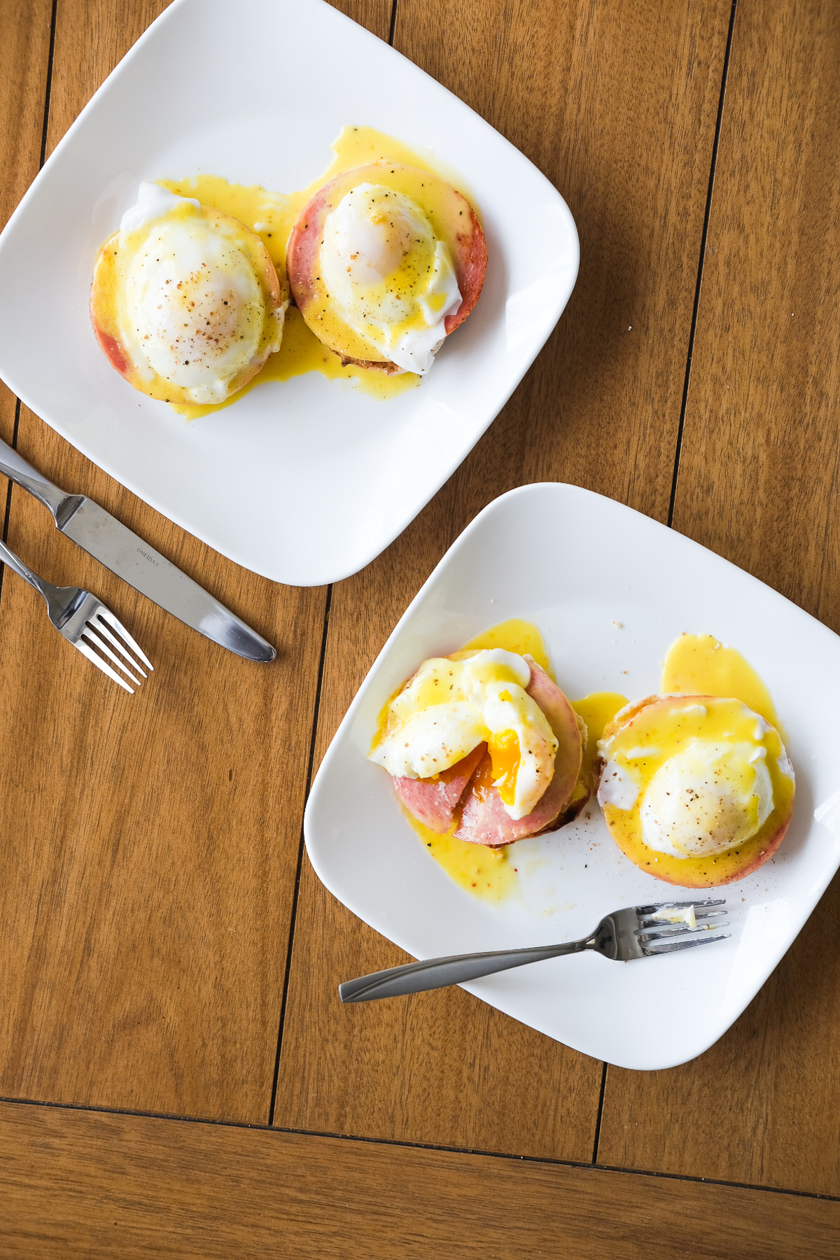 breaking into a plate of eggs benedict