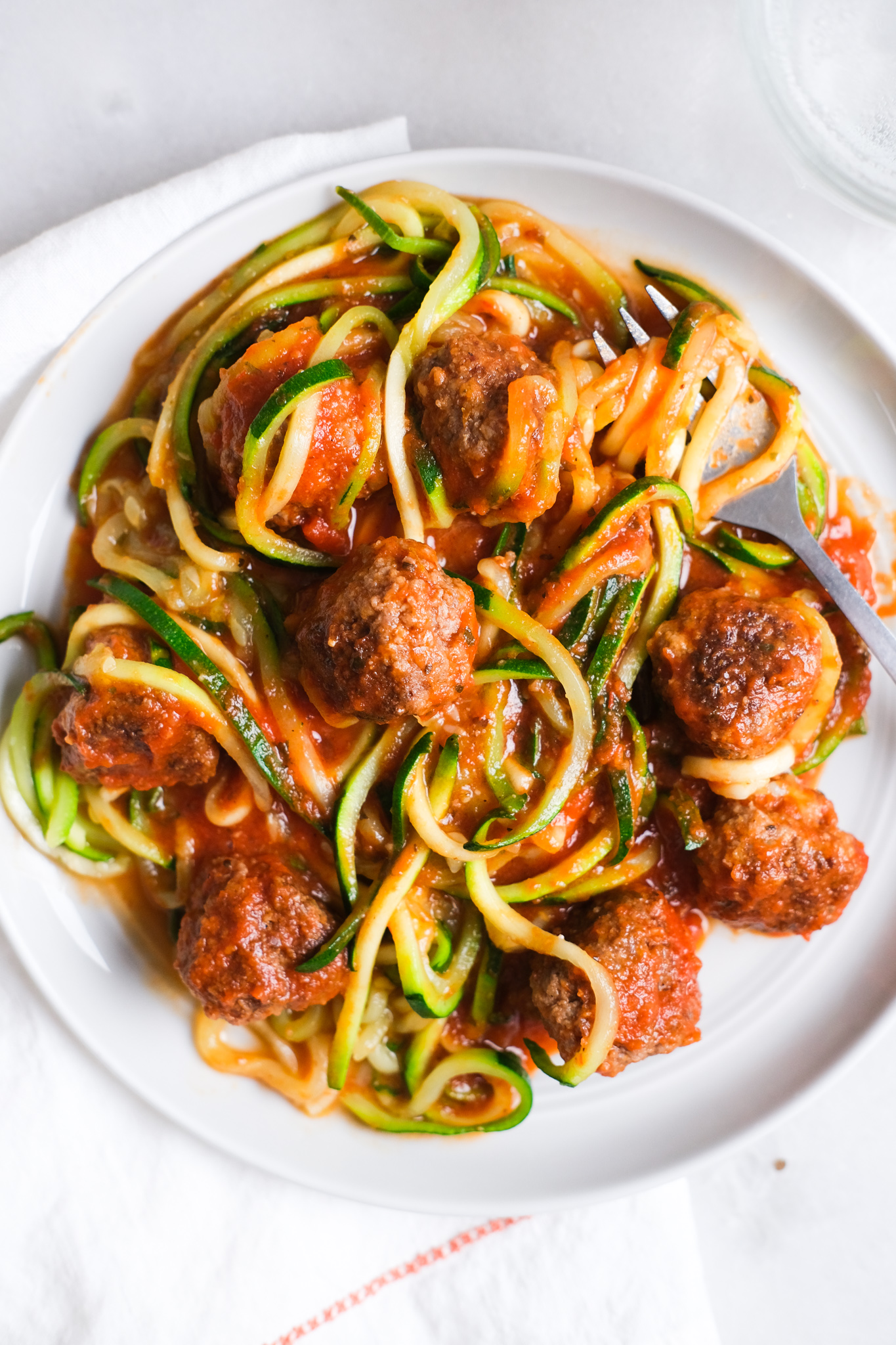 bowl of zoodles with meatballs and red sauce