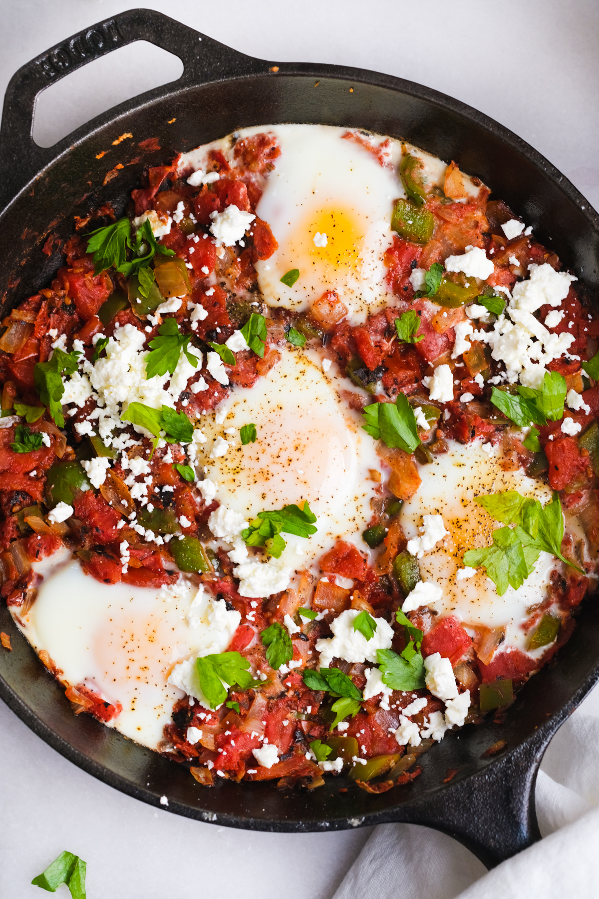 four eggs in tomato sauce for shakshuka skillet
