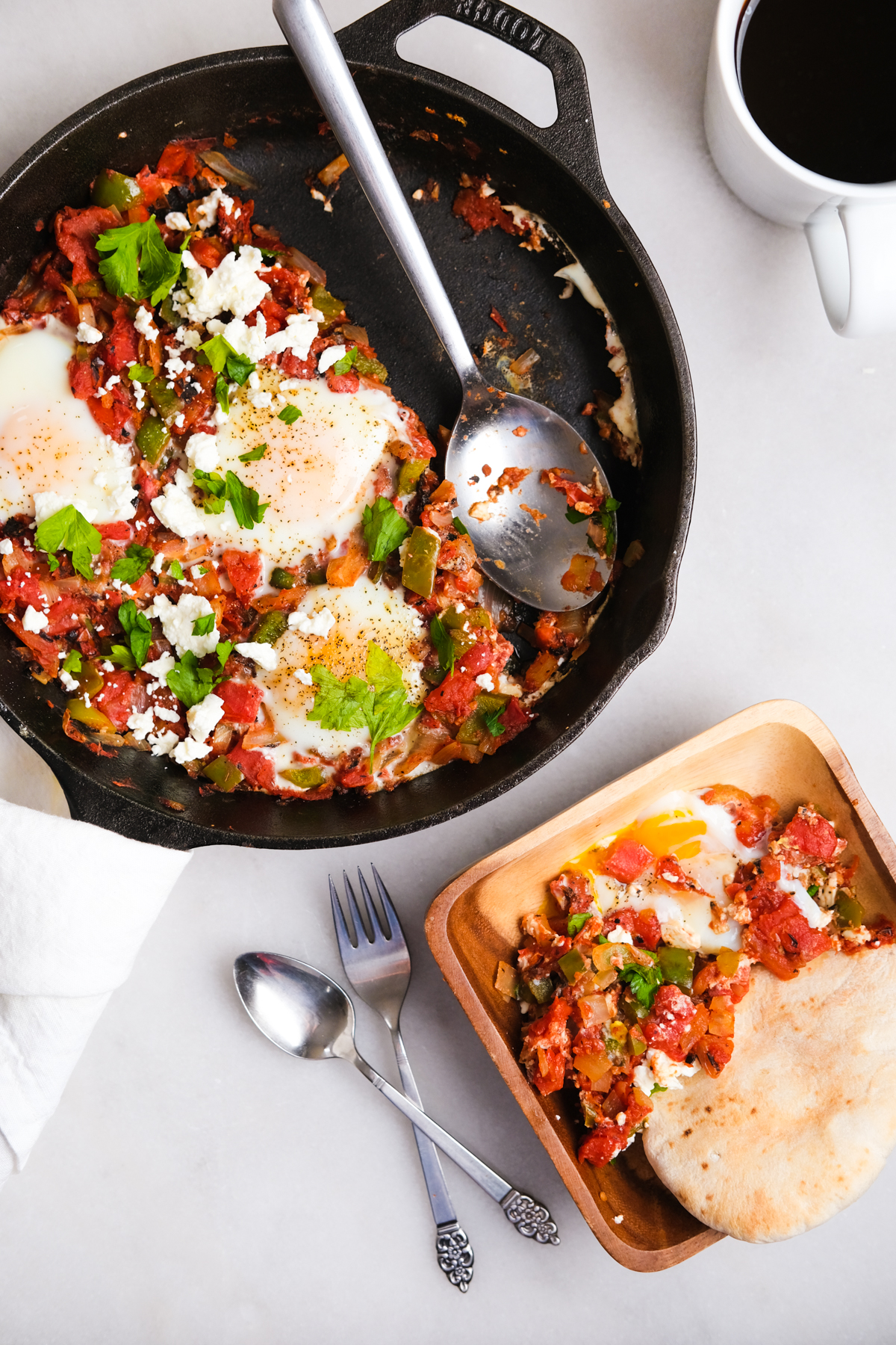 scooping out shakshuka into a bowl