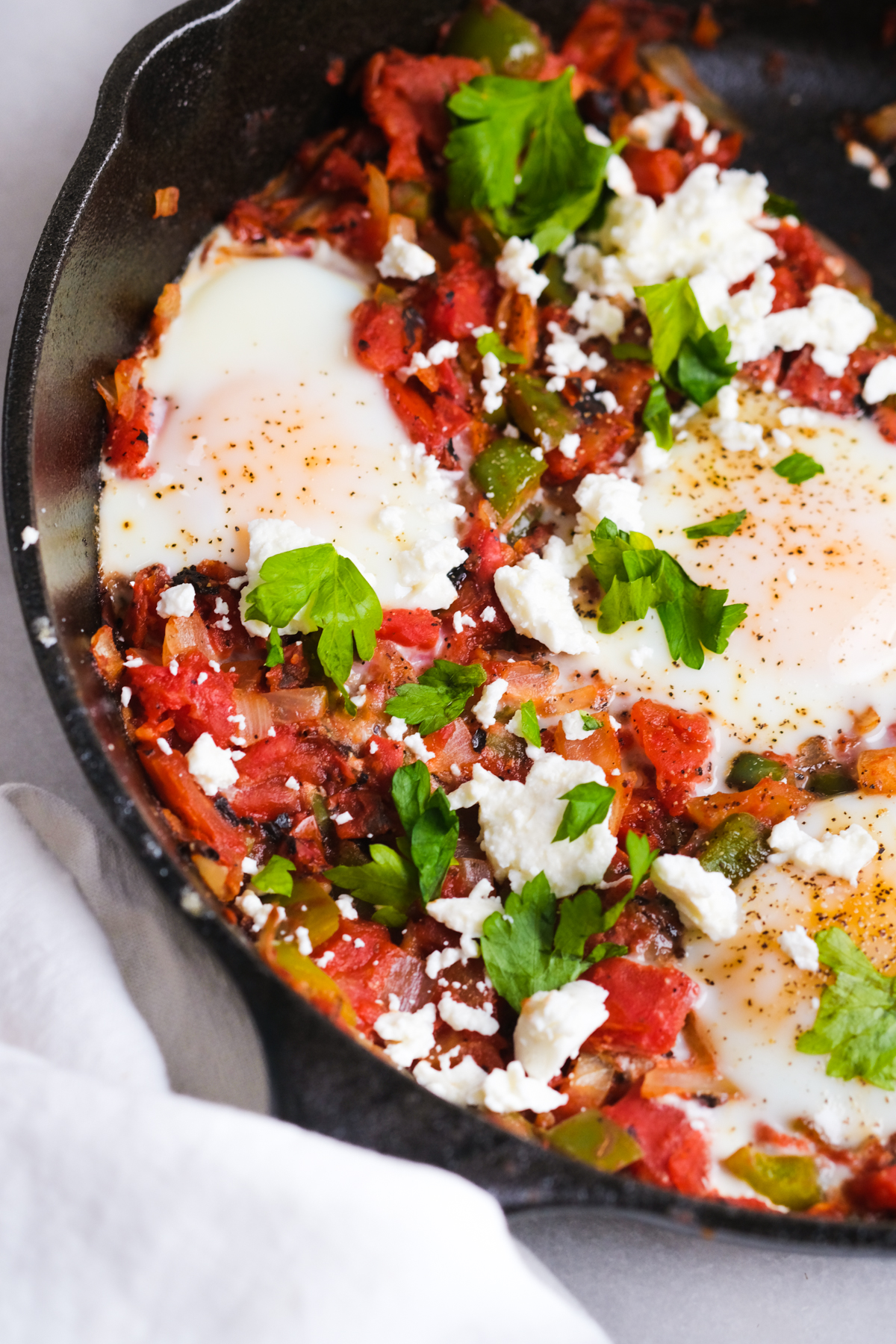 close up of shakshuka in a skillet