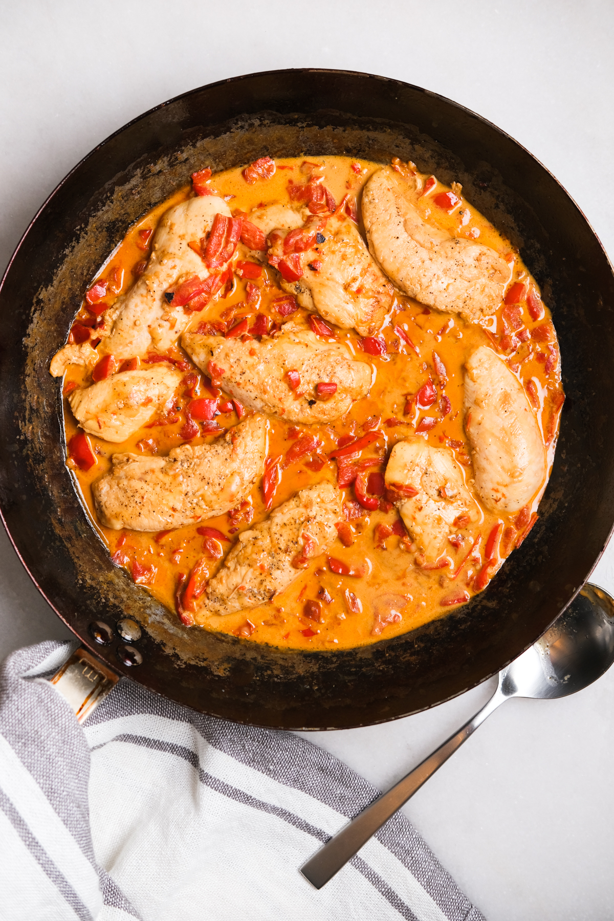 creamy roasted red pepper chicken in a skillet